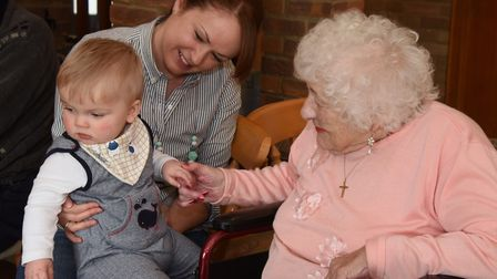 Mums and their babies and toddlers visit residents at Badgers Wood Care Home at Drayton, organised b