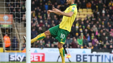 After missing a golden opportunity, Norwich City midfielder Moritz Leitner kicks the post in frustra