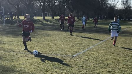 Action from the game between Newsman Valhalla and Micawbers Tavern (red) at Eaton Park. Picture: Mat