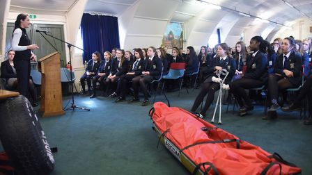 Students at Wymondham College listen to Lance Sgt Sophie Montagne, a member of the first all female