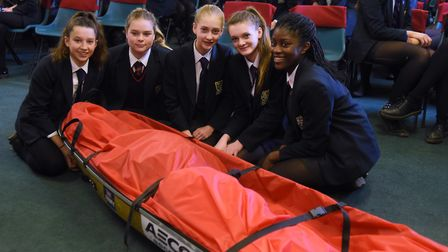 Students at Wymondham College take a look at the sledge which Lance Sgt Sophie Montagne pulled acro
