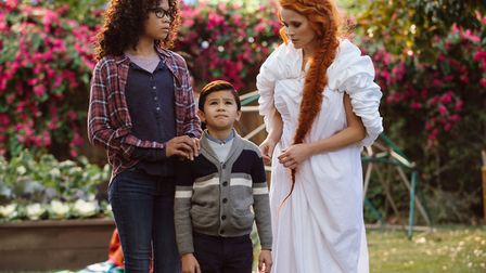 Storm Reid as Meg Murry, Deric McCabe as Charles Wallace Murry and Reese Witherspoon as Mrs Whatsit