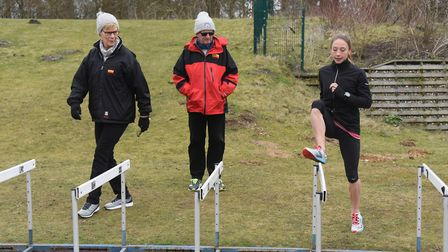 Iona Lake in training on the hurdles at the Sportspark with her coaches Pauline and Tim Ash, before