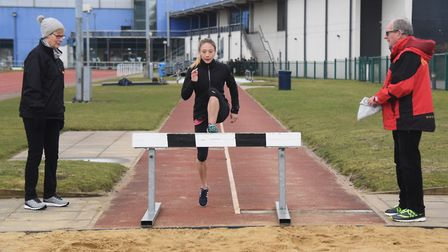 Iona Lake in training for the water jump at the Sportspark long jump with coaches Pauline and Tim As