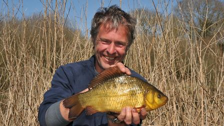 John Bailey with a glorious crucian – one of our rarest fish.Picture: John Bailey