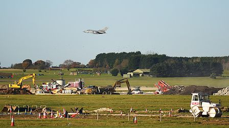 A Tornado GR4 flies over the site at RAF Marham where the second runway is under construction. Pictu