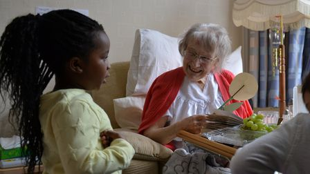 Children from the City College Norwich Nursery with residents from Laurel Lodge Care Home during the