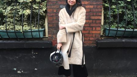Swiss exchange student Quynh Trang Do in Norwich... with cycle helmet.