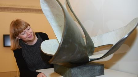 Harriet Loffler, curator of modern and contemporary art at Norwich Castle, with the sculpture Forms