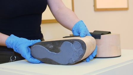 Shoes by Abigail Lane are put in place in the Visible Women exhibition at Norwich Castle. Picture: D
