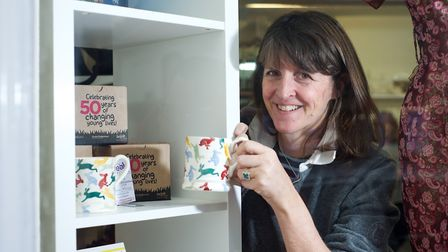 Emma Bridgewater with some of the GoGoHares mugs which are on sale in Break Charity Shop in Holt. Pi