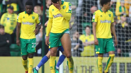 The Norwich players look dejected after conceding their second goal against Cardiff. Picture by Paul