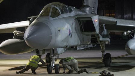 A RAF Tornado taxis into its hangar at RAF Akrotiri after conducting strikes in support of Operation