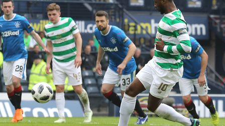 Russell Martin can only watch on as Moussa Dembele scores Celtic's third goal from the penalty spot