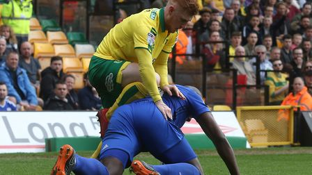 On-loan Norwich City midfielder Harrison Reed tangles with Cardiff's Sol Bamba. Picture: Paul Cheste