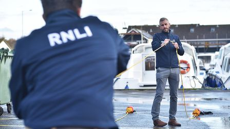 RNLI training staff at Broads Tours, in Wroxham, how to use throw bags.Picture: ANTONY KELLY
