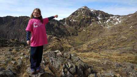 Ruby May Jennings climbing Mount Snowdon in Wales in aid of Cancer Research UK. Picture: Becki Jenni