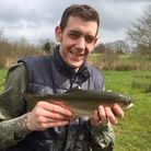 Oliver Smith with his first ever trout, caught at Rocklands Mere. Picture: James Harrold