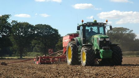 Seed drilling in north Norfolk on a rare dry day just before Easter. Picture: Kit Papworth