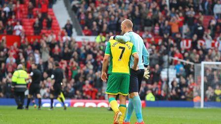 John Ruddy consoles Robert Snodgrass at the end of the Premier League match at Old Trafford in April