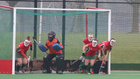 Norwich Dragons Ladies defend a penalty corner in Sunday's 2-0 loss to second-placed Canterbury II.