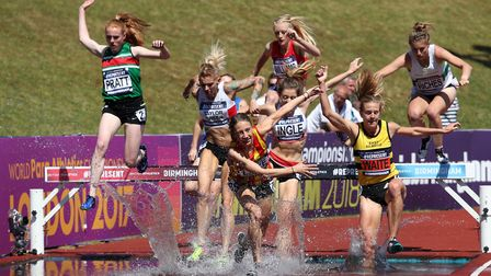 Iona Lake (centre) stumbles as she comes out of the water during the women's 3,000m steeplechase fin