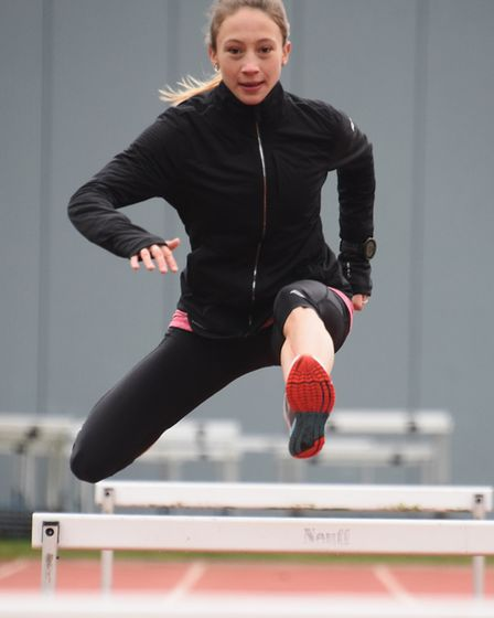 Iona Lake in training on the hurdles at the Sportspark before she takes part in the steeplechase at