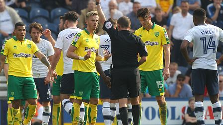 James Maddison of Norwich gets a yellow card from Referee Geoff Eltringham during the Sky Bet Champi