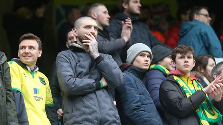 The travelling Norwich fans look dejected at the end of the match at Loftus Road. Picture: Paul Ches