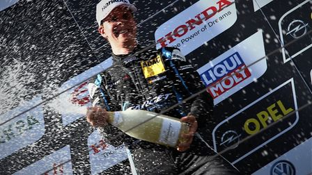 Josh Files celebrating victory at the Red Bull Ring on his way to retaining the TCR Germany title la