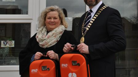 A town council has matched donations from a garage sale to provide two new defibrillators in Thorpe