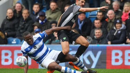 Nedum Onuoha challenges City striker Nelson Oliveira during the match at Loftus Road on Monday. Pict