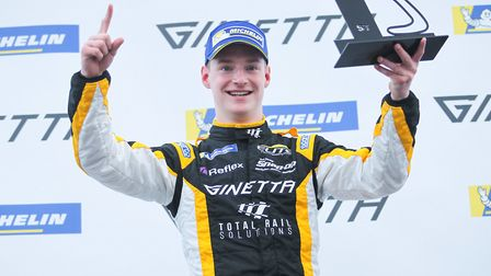 Adam Smalley celebrating victory in the opening Ginetta Junior race at Brands Hatch driving for the