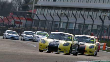 Adam Smalley leading Elite Motorsport team-mate Fin Green on his way to victory in the opening round