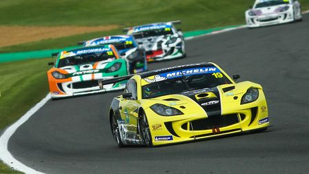 Harry King in the lead of the third Ginetta GT4 SuperCup race at Brands Hatch for the Shipdham-based