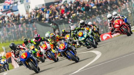 Thetford's Ryan Vickers (21) and Norwich's Grant Newstead (8) lead the charge into Paddock Hill Bend