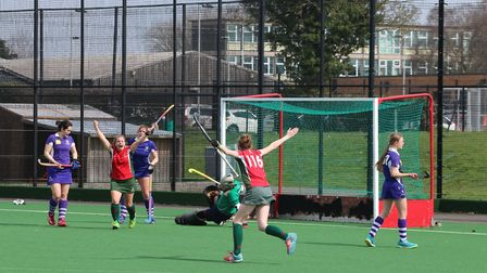 Norwich Dragons goalscorer Shelly Seaman celebrates with teammate Issy Wolfe during Saturday's 2-2 d