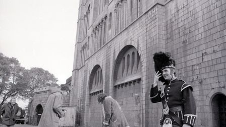 Michael Palin (right) with production staff at the filming of Monty Python's 'Queen's Own Kamikaze H