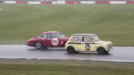 The Classic K Mini Cooper S of Billy and Carl Nairn, prepared by Snetterton Speedshop, fights off th