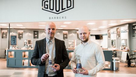 Leigh Gould pictured with Gary Bell holding Goulds Bald Polish for April Fools. Picture: Gould Barbe