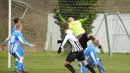 Mattishall goalkeeper, Jay Tiplady, in action against Acle. Picture: DENISE BRADLEY