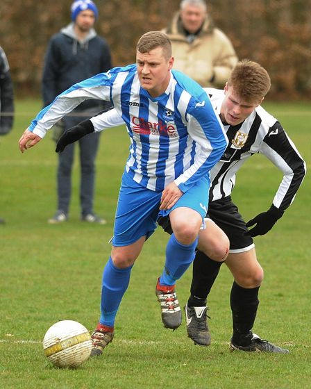Action from Acle Town (black/white) against Mattishall. Seumus Bobby for Acle and Aaron Kay for Matt