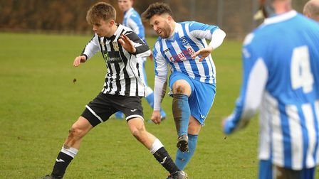 Harrison Tooley in action for Acle (black/white) with Joseph Marczewski for Mattishall. Picture: DEN