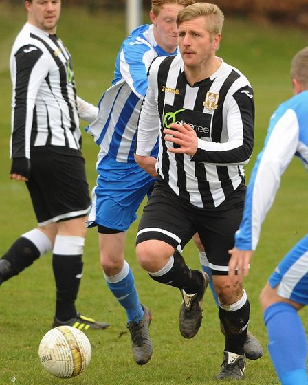 Action from Acle Town (black/white) against Mattishall. Brett Colclough, left, and Ricky Forder for