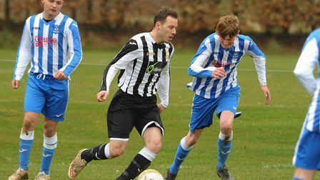 Action from Acle Town (black/white) against Mattishall. Sean Sandal for Acle and Logan Copsey, right
