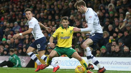 Norwich City midfielder Wes Hoolahan takes on Preston North End's Tom Barkhuizen and Josh Harrop at