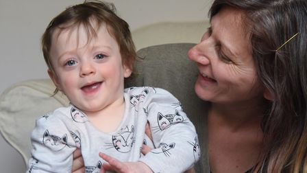 Josie Wilson with her one of her 16-month-old twins Esme, who have only been home a year after spend