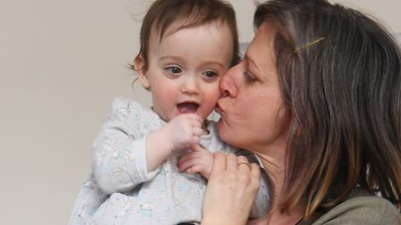 Josie Wilson with her one of her 16-month-old twins Iris, who have only been home a year after spend