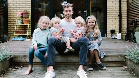 Popular parenting writer Simon Hooper, with his four daughters, who will be giving a talk at OPEN No