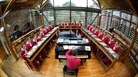 Norwich Cathedral's Master of Music Ashley Grote rehearsing with the girl choristers.Photo: Paul Hur